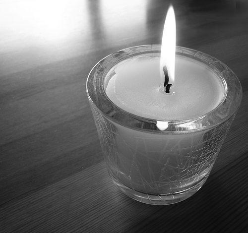 a candle burns for those who grieve
