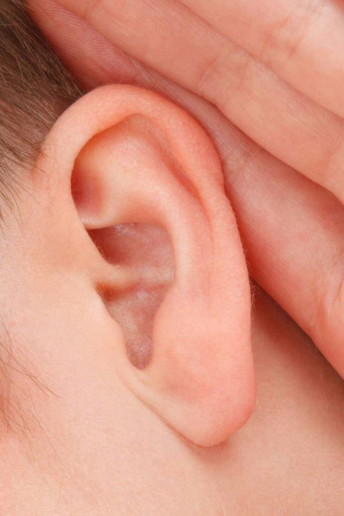 a person straining to listen